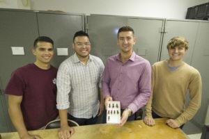 students holding king cricket specimen